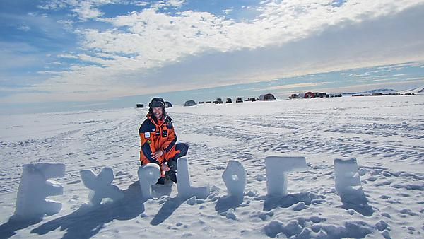 Henry Evans with the word Explore while on the International Scott Centenary Expedition to the South Pole