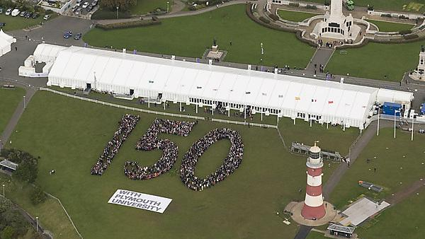People spelling out 150 on the Hoe