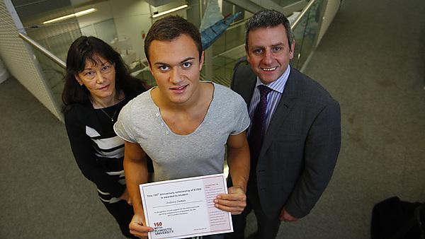 Antony James receiving a certificate from Richard Stephenson and Lesley Coulton, to signify that he is the first student to receive one of the 150 Scholarships