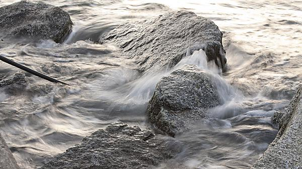 Waves breaking on rocks.