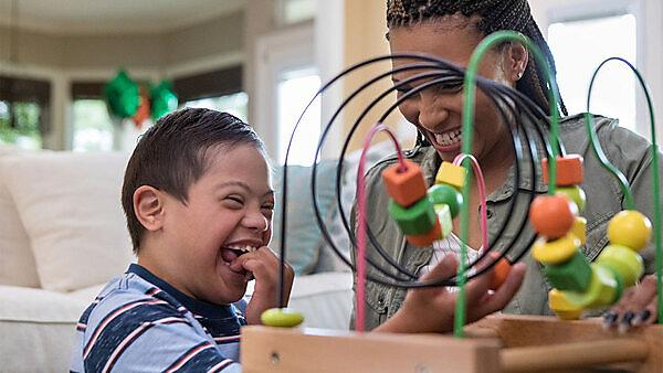 <p>When the mid adult mom and her special needs son play in the living room, they laugh together.<br></p>