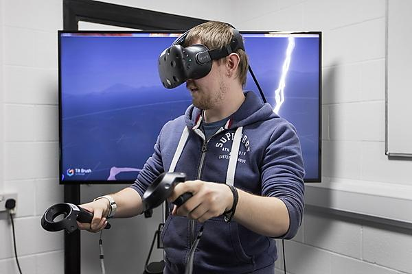 Virtual reality headset in use in built game environments