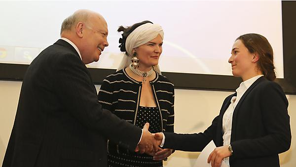 Student Stefania Giui receives her award from Lord and Lady Fellowes