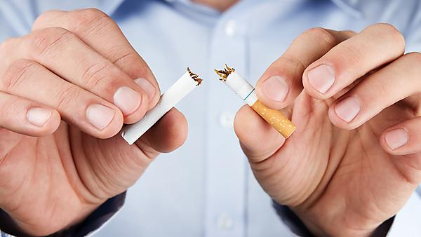 Quit smoking, human hands breaking the cigarette (Shutterstock)