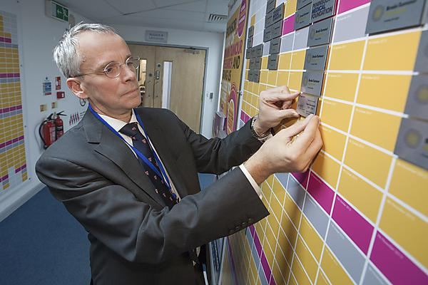 Professor Oliver Hanemann, Associate Dean Research and Research Lead for Brain Tumour, Plymouth University, looks over the Wall of Hope at the John Bull Building