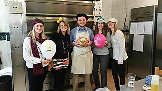 Staff at the Column Bakehouse celebrate Brain Tumour Research Wear A Hat Day 2015