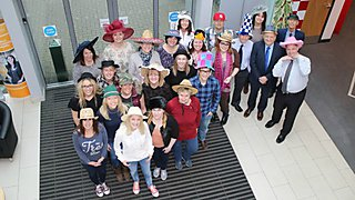 Staff at Vospers, Marsh Mills, Plymouth, celebrate Brain Tumour Research Wear A Hat Day 2015