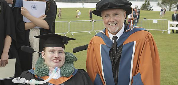 Jonathan Brough at his graduation ceremony in September 2014 with Queen drummer Roger Taylor, who was awarded an honorary doctorate the same day