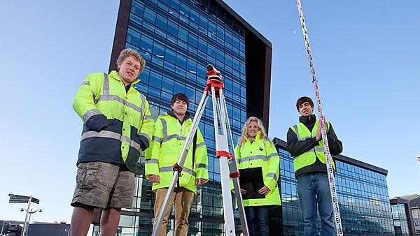 Plymouth University Civil coastal engineering students surveying on campus.