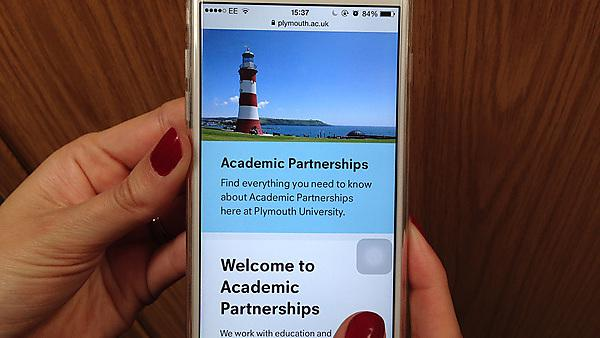 Academic Partnerships webpage on an iPhone