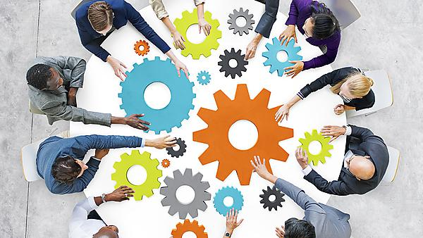 Business people with gears and teamwork concept courtesy of Shutterstock