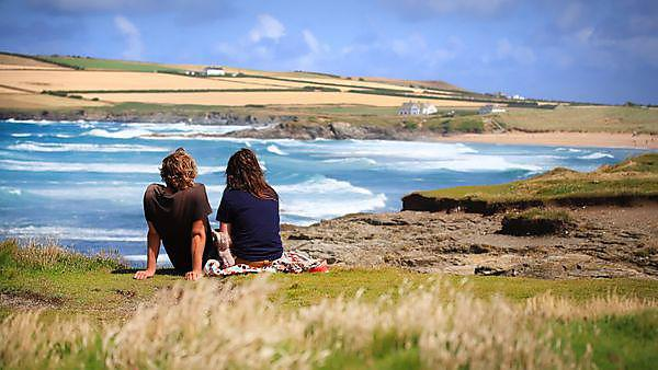Two students sat on the cliffs watching the sea