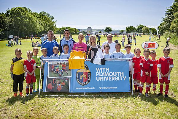 Members of the Devon Junior and Minor League with representatives from Brain Tumour Research, Santander and Plymouth University