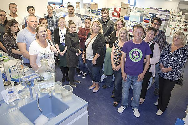Local people affected by Huntington's disease visit labs where a treatment is being sought