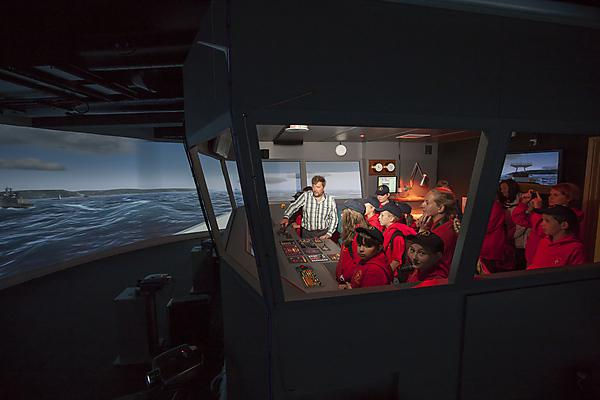 Children navigating a ship in the simulator at Plymouth University