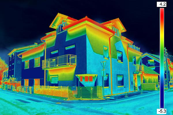 Infrared thermovision image showing lack of thermal insulation on house [shutterstock_274896908]