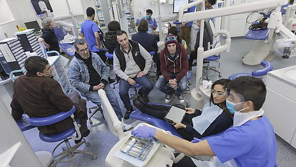 Devonport House service users visit the local Dental Education Facility for dental health information from students
