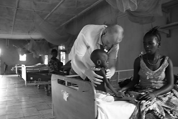 Dr Austin Hunt caring for a patient at Masanga Hospital in Sierra Leone