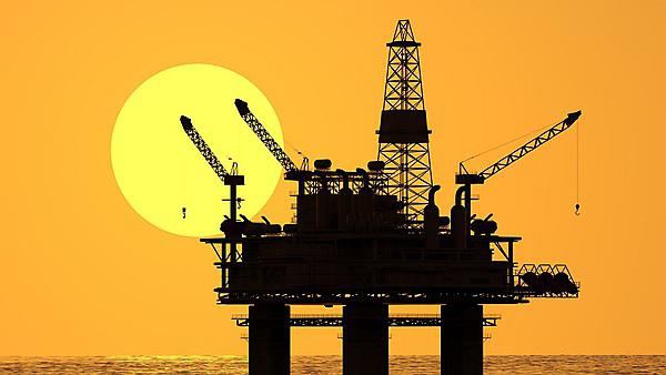 Oil platform at sunset [shutterstock_124714078]
